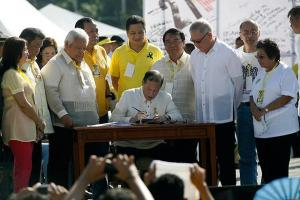 President Benigno Aquino signing Human Rights Victim Reparation and Recognition Act of 2013