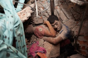 The sad image of a final embrace in the Bangladesh garment factory disaster.