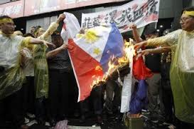 Taiwan citizens burning the Philippine flag in protest over the killing of a Taiwanese fisherman