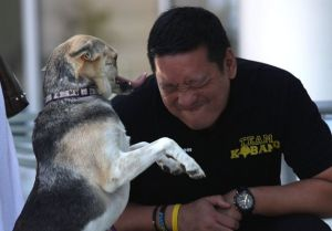 Kabang plays with new owner, veterinarian Anton Lim
