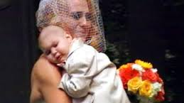 Mother carrying sick son who stood as best man on her wedding day