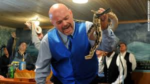 Coots handling venomous snake during church service.