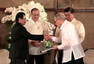The draft BBL presented by President Aquino and MILF's Mohagher Iqbal to Senate President Franklin  Drilon and Speaker of the House Feliciano Belmonte Jr.