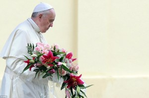 Pope Francis laying wreath at Italy's largest war memorial.