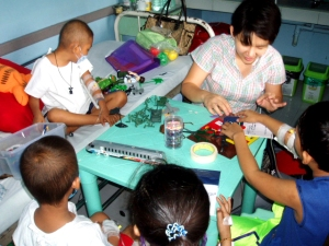 Dr. Angie with cancer-stricken children.