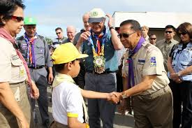 Vice President Jejomar Binay doing a Boy Scout handshake.