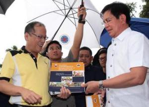 PARR Secretary Panfilo Lacson handling President Aquino a copy of the Yolanda CRRP.
