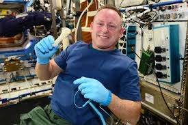 Astronaut Barry Wilmore with his space fabricated ratcheting socket wrench.