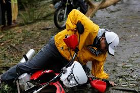 DILG Secretary Mar Roxas falling from his motorycle while doing work in Samar.