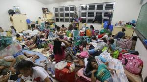 Evacuees occupying school room as their temporary shelter.
