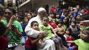 Pope Francis with homeless children.
