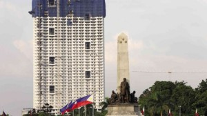 The Rizal monument with the monstrous Torre de Manila condominium rising at the back.