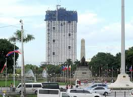 Torre de Manila at the background dwarfing the Rizal monument.