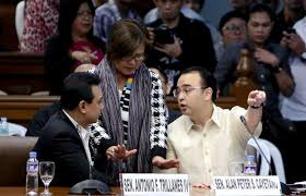 Sen. Leila de Lima mediating at the warring Senators Trillanes and Cayetano.