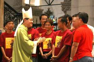 Manila Archbishop Luis Antonio Cardinal Tagle with a group involved in illegal drugs.