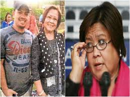 Sen. de Lima with Kerwin Espinosa, but the senator denies knowing the Espinosas.
