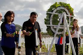 President Rodrigo Duterte with Vice President Leni Robredo and Tacloban City Mayor Cristina Romualdez lighting candles during the 3rd Yolanda anniversary.